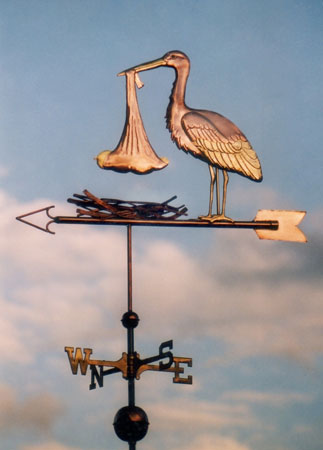 stork weathervane with baby standing