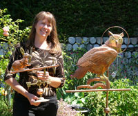 LizAnne In Garden With Owl Weathervane P